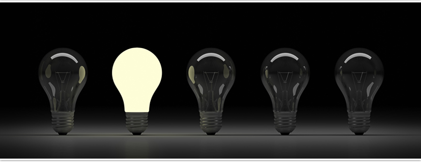A lit lightbulb among others not lit.  Symbolizing a bright thought among other resting bulbs